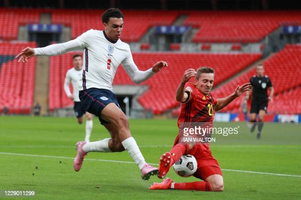 England's defender Trent Alexander-Arnold is challenged by Belgium's defender Timothy Castagne during the UEFA Nations League group A2 football match...