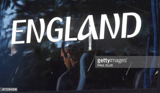 England's defender Trent AlexanderArnold is seen on the bus carrying the England football team as they arrive at the team hotel in Repino Russia on...