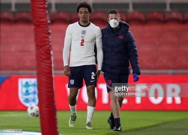 England's defender Trent Alexander-Arnold leaves the pitch injured during the international friendly football match between England and Austria at...