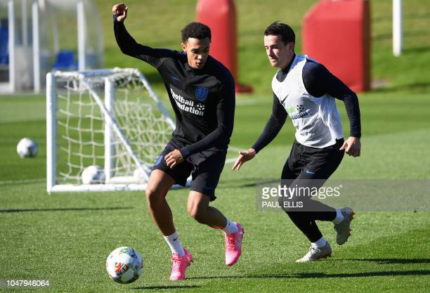 England's defender Trent AlexanderArnold vies with England's defender Ben Chilwell during an open training session at St George's Park in...