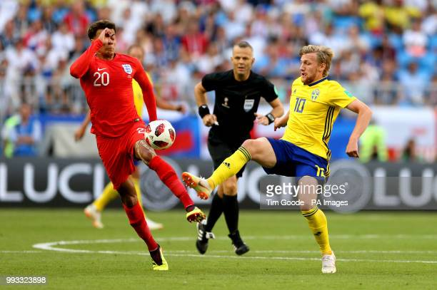 England's Dele Alli and Sweden's Emil Forsberg battle for the ball during the FIFA World Cup Quarter Final match at the Samara Stadium