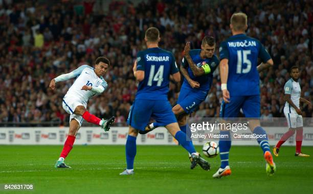 England's Dele Alli shoots at goal during the FIFA 2018 World Cup Qualifier between England and Slovakia at Wembley Stadium on September 4 2017 in...
