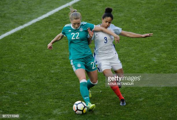 England's Demi Stokes fights for the ball with Keira Walsh of Germany during a SheBelieves Cup soccer match between England and the Germany at the...