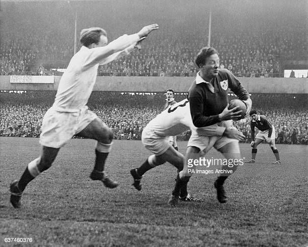 England's Dickie Jeeps flies in to add his weight as teammate Jeff Butterfield tackles Ireland's Jackie Kyle