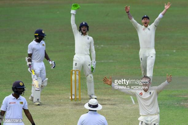 England's Dom Bess appeals unsuccessfully for a leg before wicket decision against Sri Lanka's Cricket XI Sangeeth Cooray during the second day of a...
