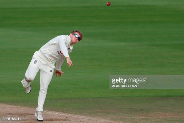 England's Dom Bess bowls on the fourth day of the third Test cricket match between England and Pakistan at the Ageas Bowl in Southampton, southern...