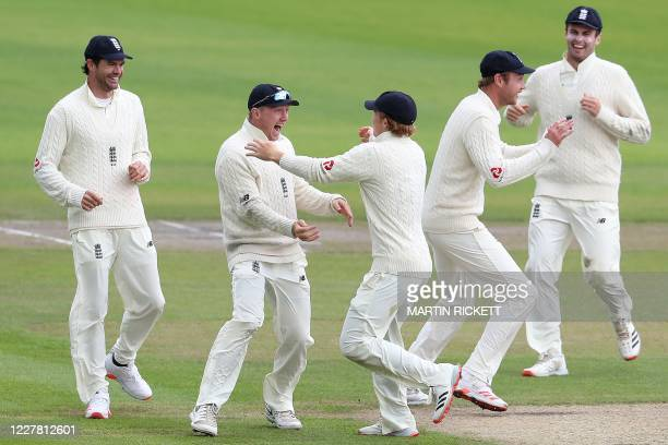 England's Dom Bess celebrates with team mates after taking the wicket of West Indies' Roston Chase for seven runs on the final day of the third Test...