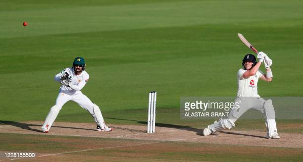 England's Dom Bess hits the ball for four runs on the second day of the third Test cricket match between England and Pakistan at the Ageas Bowl in...