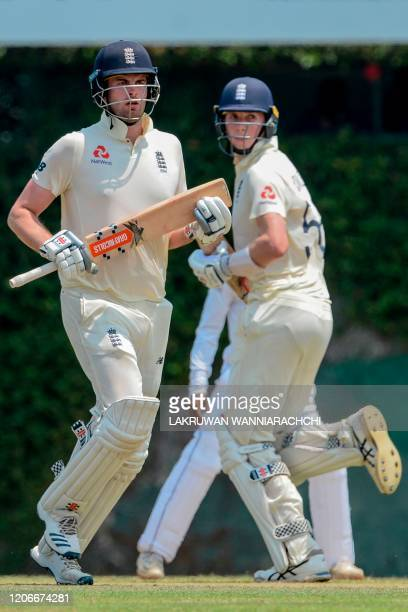 England's Dom Sibley and Zak Crawley run between the wickets during the opening day of a fourday practice match between Sri Lanka Board President's...
