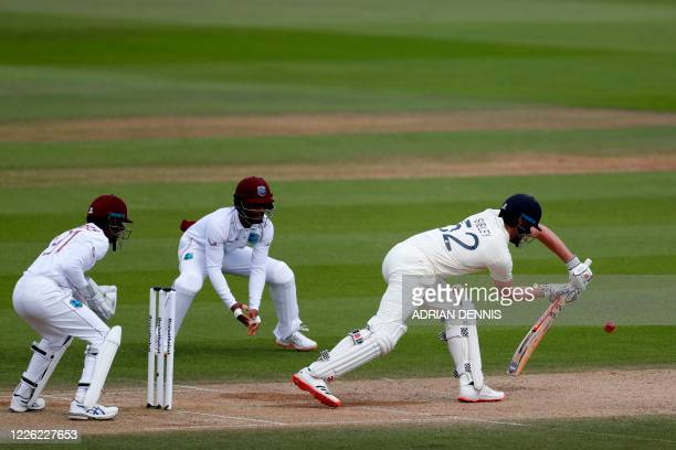 England's Dom Sibley plays a forward defensive shot on the fourth day of the first Test cricket match between England and the West Indies at the...