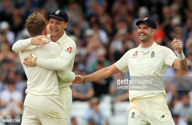 England's Dominic Bess celebrates with England's Jos Buttler and England's James Anderson after taking the wicket Pakistan's ImamulHaq for 34 on the...