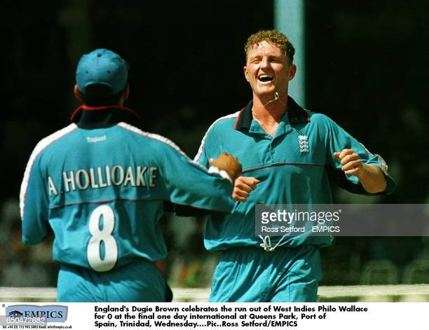 England's Dougie Brown celebrates the run out of West Indies' Philo Wallace for a duck