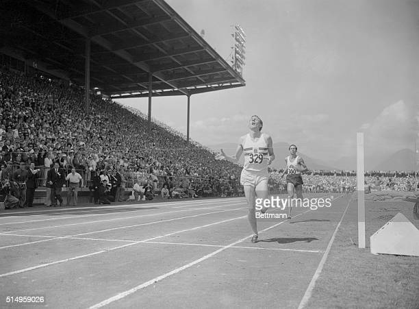 England's Dr Roger Bannister breaks the tape in the onemile final at the British Empire Games in Vancouver 8/7 Close behind is Australia's John Landy...