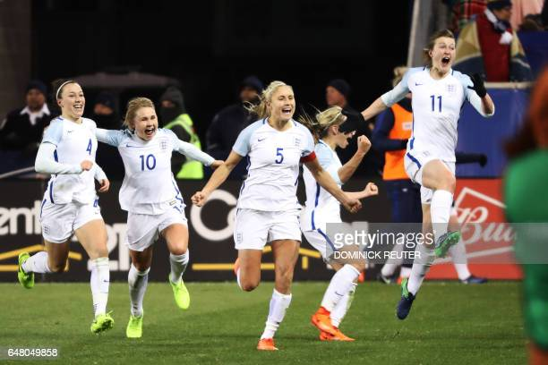 England's Ellen White leaps into the air after scoring the goahead goal against the United States as the United States and England women's national...