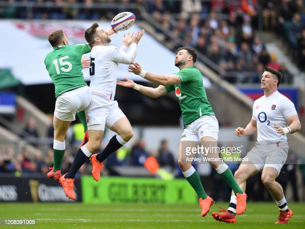 England's Elliot Daly battles for possession with Ireland's Jordan Larmour during the 2020 Guinness Six Nations match between England and Ireland at...