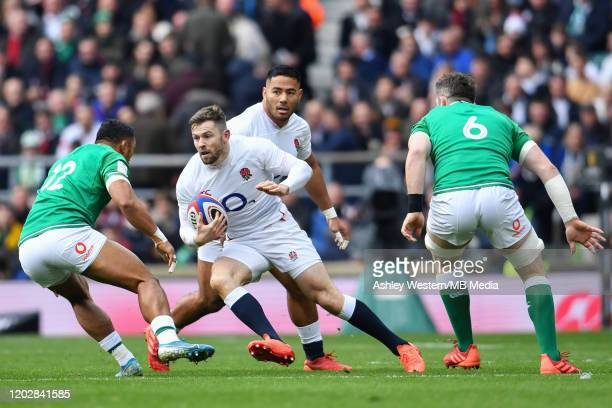 England's Elliot Daly under pressure from Ireland's Bundee Aki during the 2020 Guinness Six Nations match between England and Ireland at Twickenham...