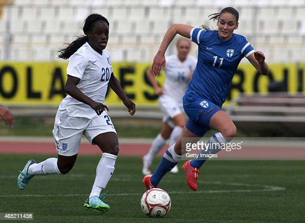 England's Eni Aluko and Finland's Nora Heroum in action during the Cyprus Cup match between England and Finland at GSZ stadium on March 4 2015 in...