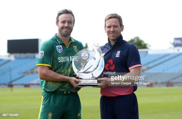 England's Eoin Morgan and South Africa's AB deVilliers pose for a photograph with the Royal London One Day International trophy at Headingley Leeds