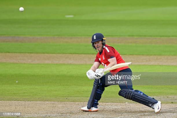 England's Eoin Morgan hits his first ball to the boundary during the international Twenty20 cricket match between England and Pakistan at Old...
