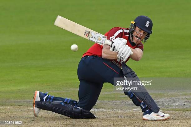 England's Eoin Morgan plays a shot during the international Twenty20 cricket match between England and Pakistan at Old Trafford cricket ground in...