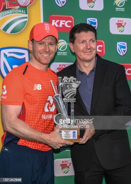 England's Eoin Morgan poses with the trophy after being awarded the Man of the Match after the third T20 International cricket match between South...