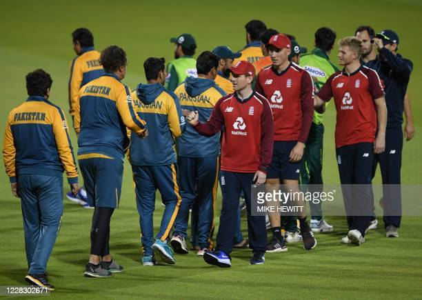 England's Eoin Morgan shakes hands with the Pakistan players as they celebrate winning by five runs after the international Twenty20 cricket match...