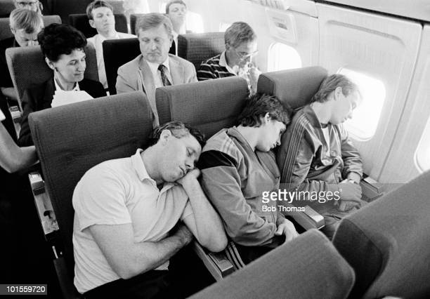 England's Everton trio left to right Peter Reid Gary Lineker and Trevor Steven get some rest on the flight to join the England football team in...