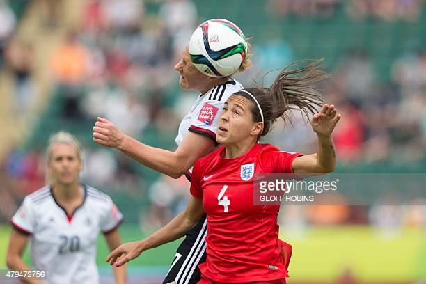 England's Fara Williams and Germany's Melanie Behringer vie for the ball during the bronze medal match at the FIFA Women's World Cup in Edmonton...