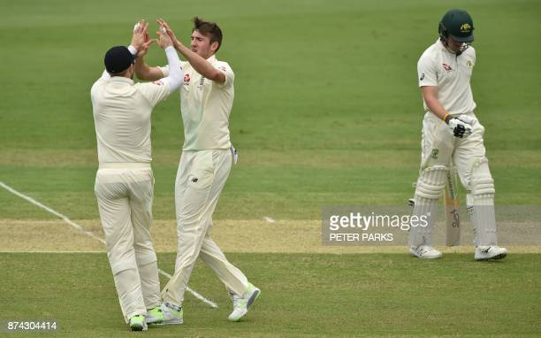 England's fast bowler Craig Overton celebrates the wicket of Cricket Australia XI batsman Will Pucovski on the first day of a fourday Ashes tour...