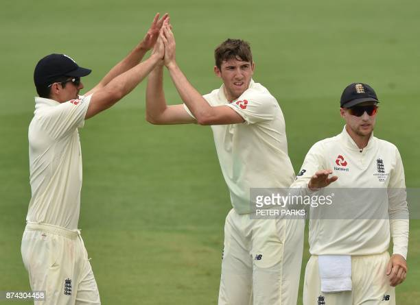 England's fast bowler Craig Overton celebrates with Alastair Cook after taking the wicket of Cricket Australia XI batsman Will Pucovski on the first...