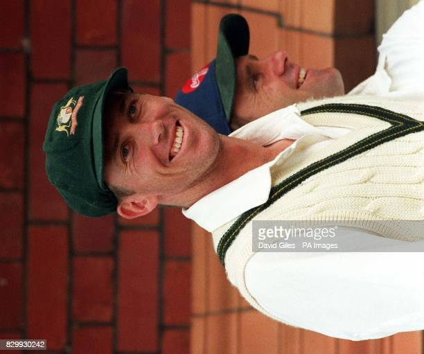 England's firstinnings executioner Australian paceman Glenn McGrath and Australian captain Mike Taylor react following play at Lords today Englands...