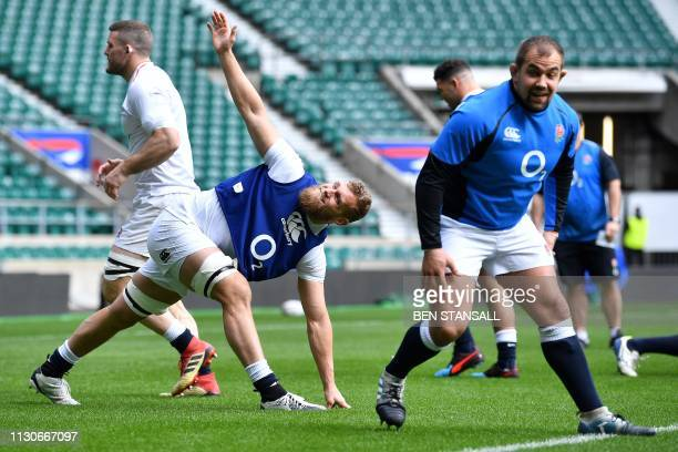 England's flanker Brad Shields and England's prop Ben Moon attend the captain's run training session at Twickenham stadium in south west London on...