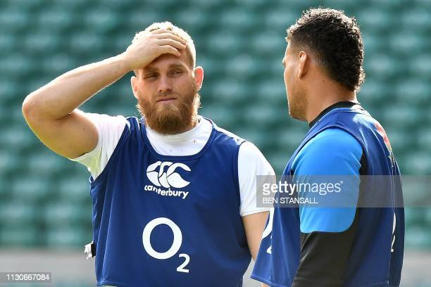 England's flanker Brad Shields talks with England's Nathan Hughes during the captain's run training session at Twickenham stadium in south west...