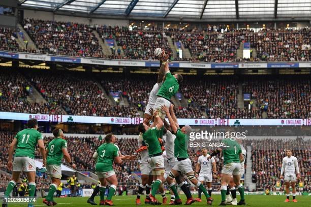 England's flanker Courtney Lawes and Ireland's flanker Peter O'Mahony compete for the ball in the lineout during the Six Nations international rugby...