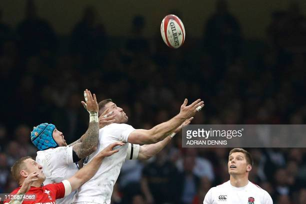 TOPSHOT England's flanker Mark Wilson jumps for a high ball during the Six Nations international rugby union match between Wales and England at the...