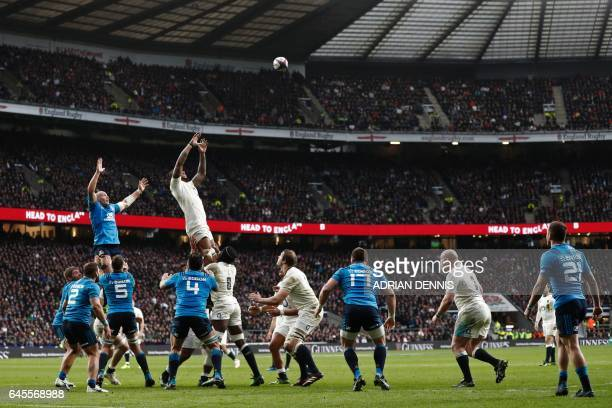 England's flanker Maro Itoje and Italy's number 8 Sergio Parisse are lifted high to contest a lineout during the Six Nations international rugby...