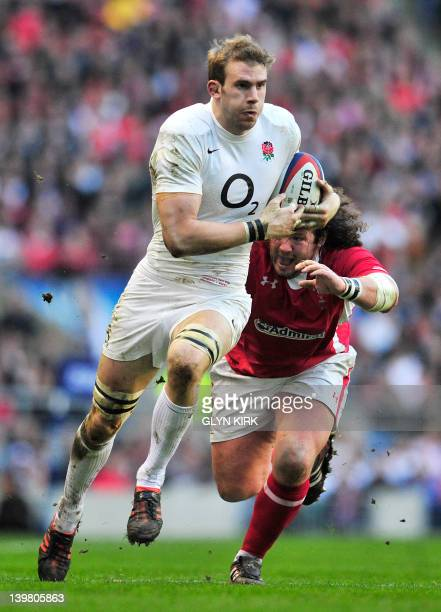 England's flanker Tom Croft runs past Wales' prop Adam Jones during the 6 Nations International rugby union match between England and Wales at...