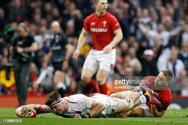 England's flanker Tom Curry scores the first try of the Six Nations international rugby union match between Wales and England at the Principality...