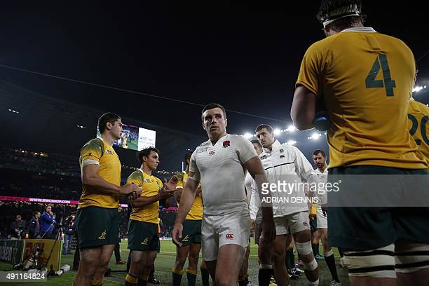 England's fly half George Ford leaves the pitch with teammates folowing a Pool A match of the 2015 Rugby World Cup between England and Australia at...