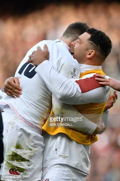 England's flyhalf George Ford celebrates with England's Ellis Genge after scoring their second try during the Six Nations international rugby union...