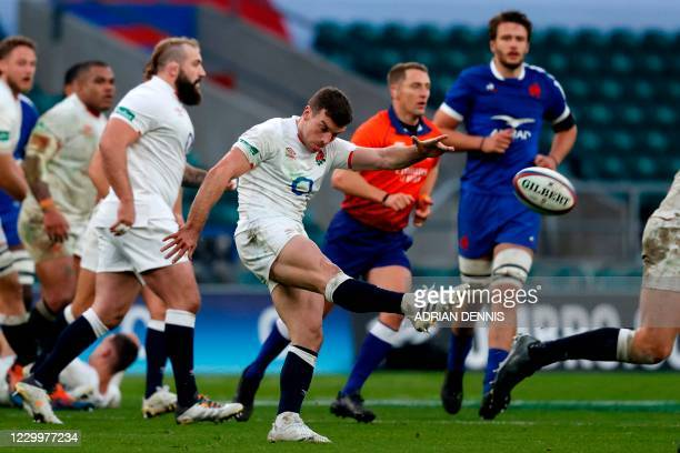 England's fly-half George Ford kicks the ball up-field during the final of the Autumn Nations Cup international rugby union series between England...