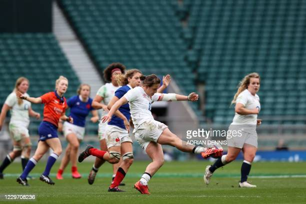 England's fly-half Katy Daley-Mclean kicks the ball during the international women's rugby union match between England Women and France Women at...
