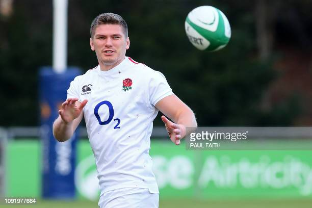 England's flyhalf Owen Farrell catches the ball during the England captain's run training session at University College Dublin on February 1 on the...
