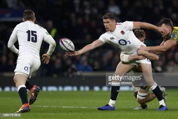England's fly-half Owen Farrell offloads to England's full-back Elliot Daly for him to score a try during the international rugby union test match...