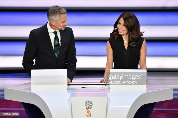 England's former forward and draw conductor Gary Lineker and Russian sports journalist and draw conductor Maria Komandnaya speak during the Final...