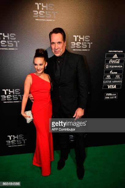 England's former goalkeeper David Seaman and his wife Frankie Poultney pose for a photograph as they arrive for The Best FIFA Football Awards...
