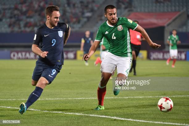 England's forward Adam Armstrong and Mexico's defender Juan Aguayo compete for the ball during the U20 World Cup quarterfinal football match between...