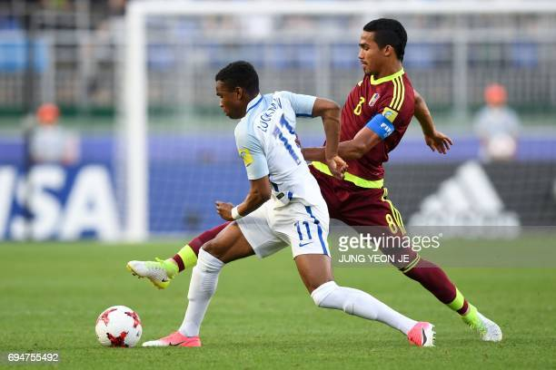 England's forward Ademola Lookman and Venezuela's midfielder Yangel Herrera compete for the ball during the U20 World Cup final football match...