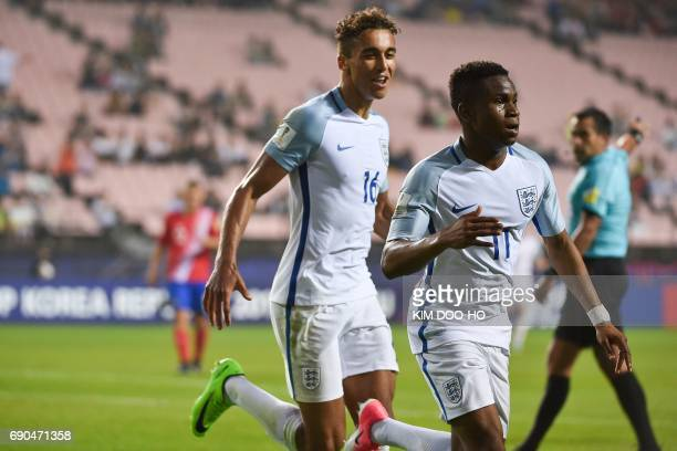 England's forward Ademola Lookman celebrates beside teammate Dominic CalvertLewin after scoring during their U20 World Cup round of 16 football match...