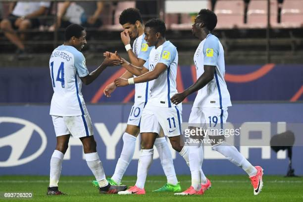 England's forward Ademola Lookman celebrates his goal with teammates during the U20 World Cup semifinal football match between England and Italy in...